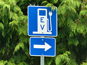 electric vehicle charging station sign with a directional arrow
